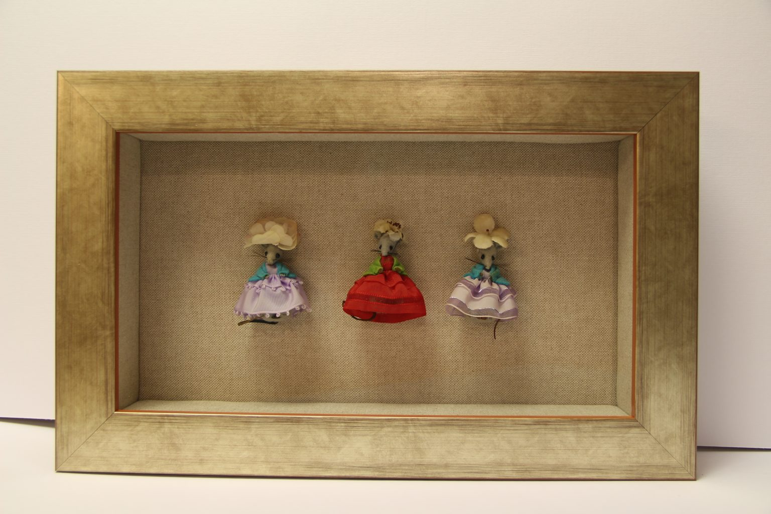 Three little mice in linen lined box frame